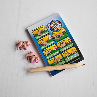 "PASS THE PIGS<sup>&reg;</sup> Dice Game - Toss these tiny pig ""dice"" and and score points for each pose in this fun family dice game.  Game includes plastic ""Pig Sty"" dice cup with lid, 2 pig dice, 1 pencil, pig scoring guide and pad and illustrated instructions.  Ages 7 and up. 2 or more players."